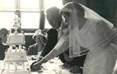 Gordon and Margaret Jacob cutting their wedding cake
